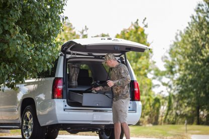 Safely and securely store your gear in a SUV Cargo Caddy